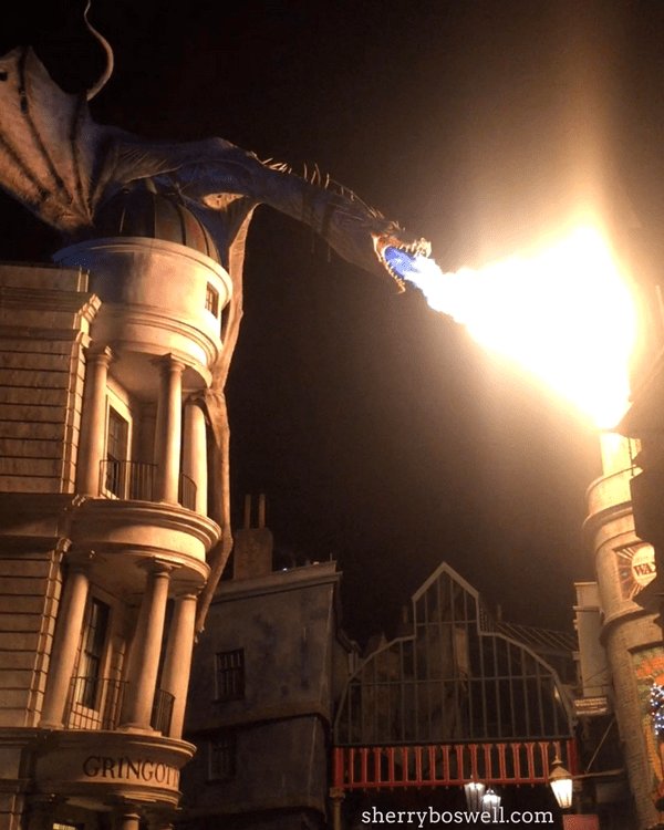 Universal Orlando's Wizarding World of Harry Potter tips | The dragon about Gringott's Bank inside Diagon Alley lights up the night sky with flames.