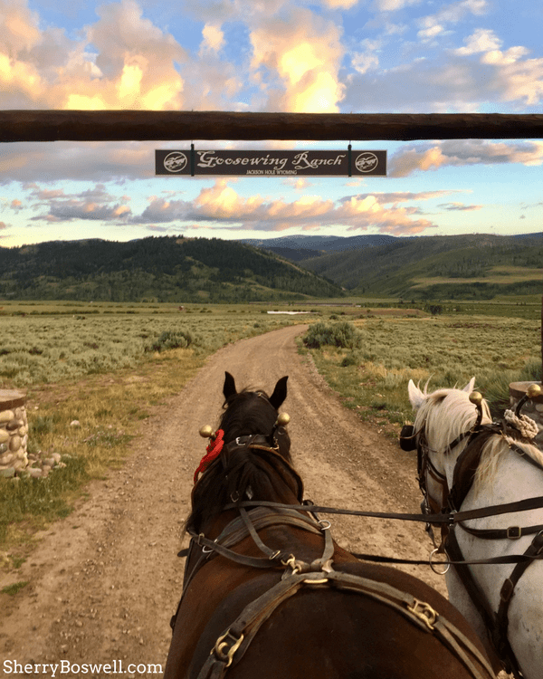 18 Travel Destinations in 2018 | Dude ranch activities like this sunset horse drawn wagon ride singalong make magical moments for family travelers.