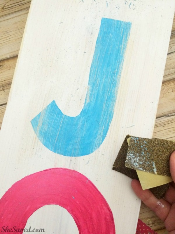This fun homemade Joy sign will add so much to your holiday decor, and it's easy to make!