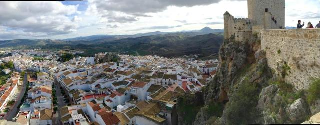 A small white village with a castle beats a big international city any day, in my opinion. You could live in a town like Olvera with Spain's cultural ambassador program.