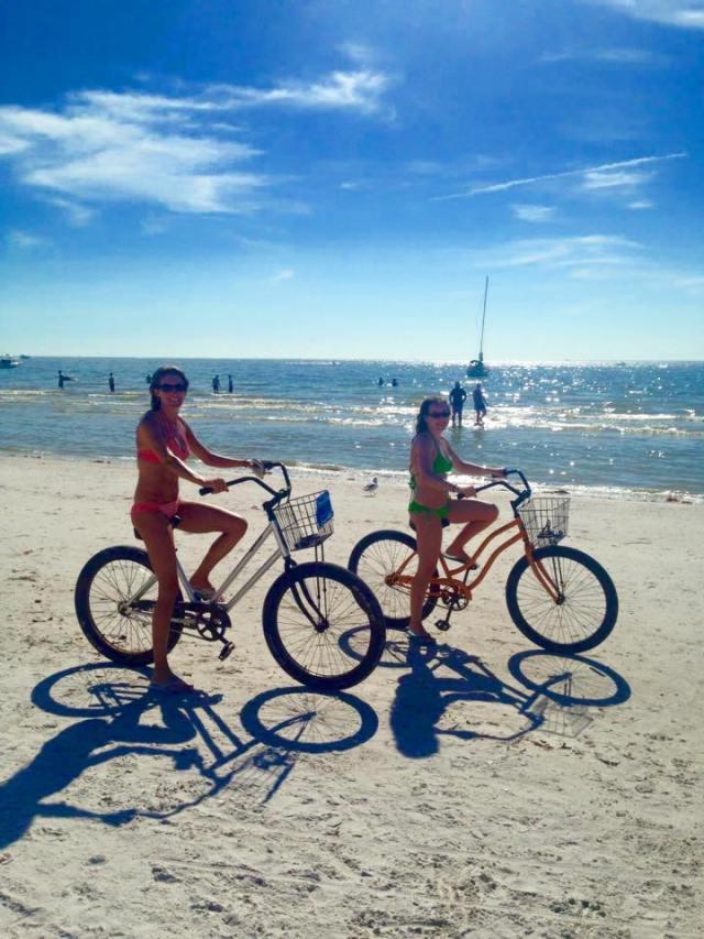 < Bikes on the beach >