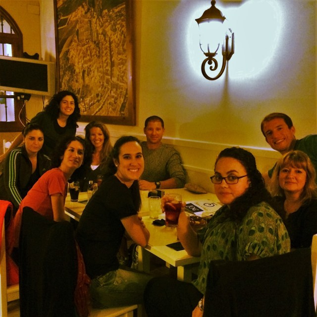 < Friends at dinner in Spain >
