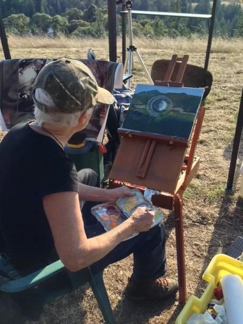 Sue painting at Terra Sophia - photo by Christine Saba