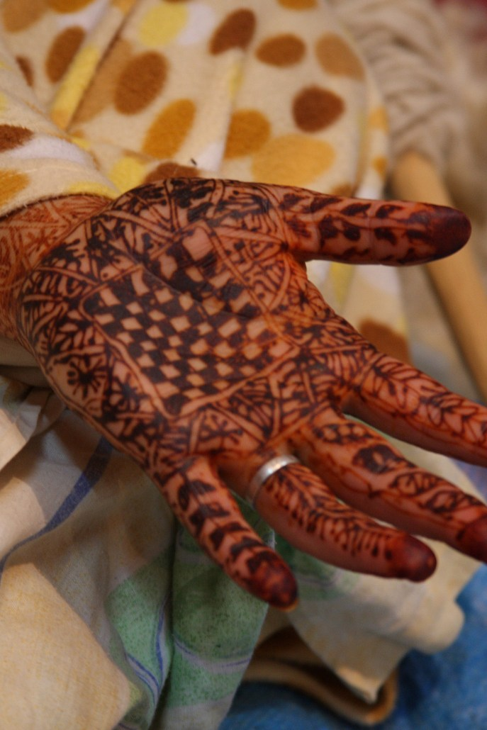 A woman's henna-adorned hand