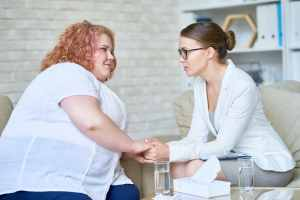 Obese young Woman in Psychotherapy Session