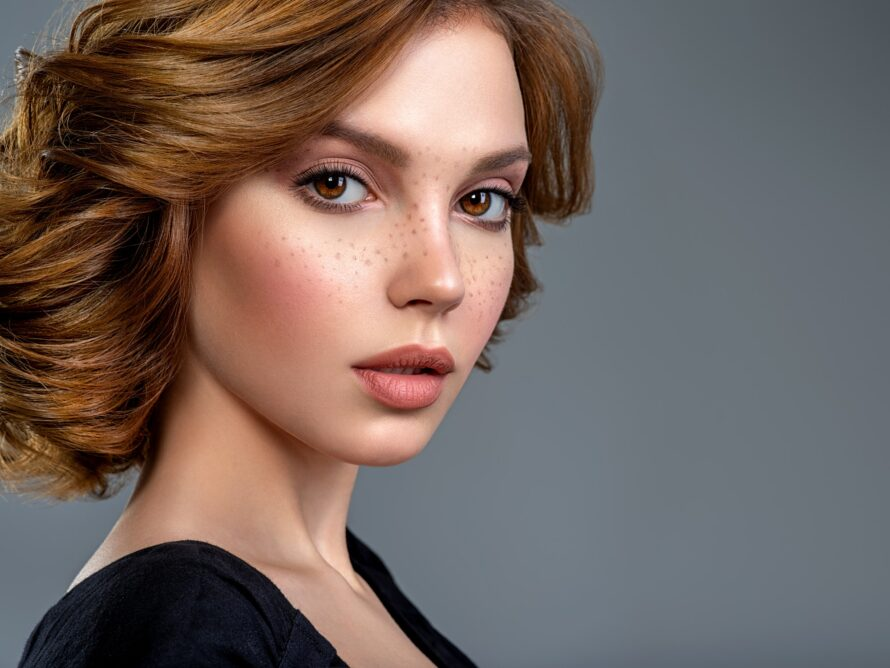 Beautiful face of a woman has botox and dermal fillers in the face and lips