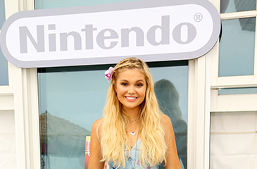 Olivia Holt Celebrates 18th Birthday in Style with a Nintendo Beach Party