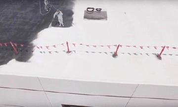 Man applying spray roofing