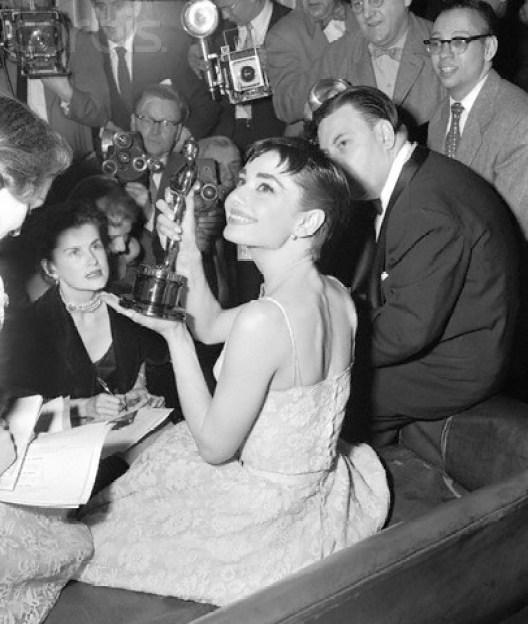 Audrey Hepburn Showing Oscar to Reporters