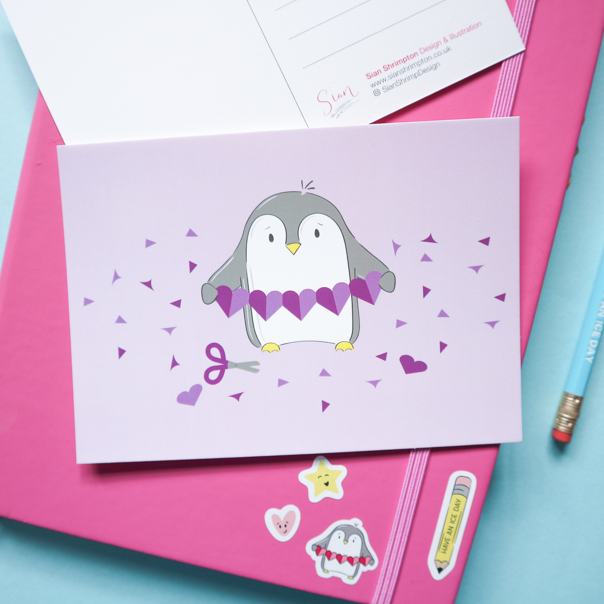 Penguin Purple Heart Garland Postcard by Sian Shrimpton