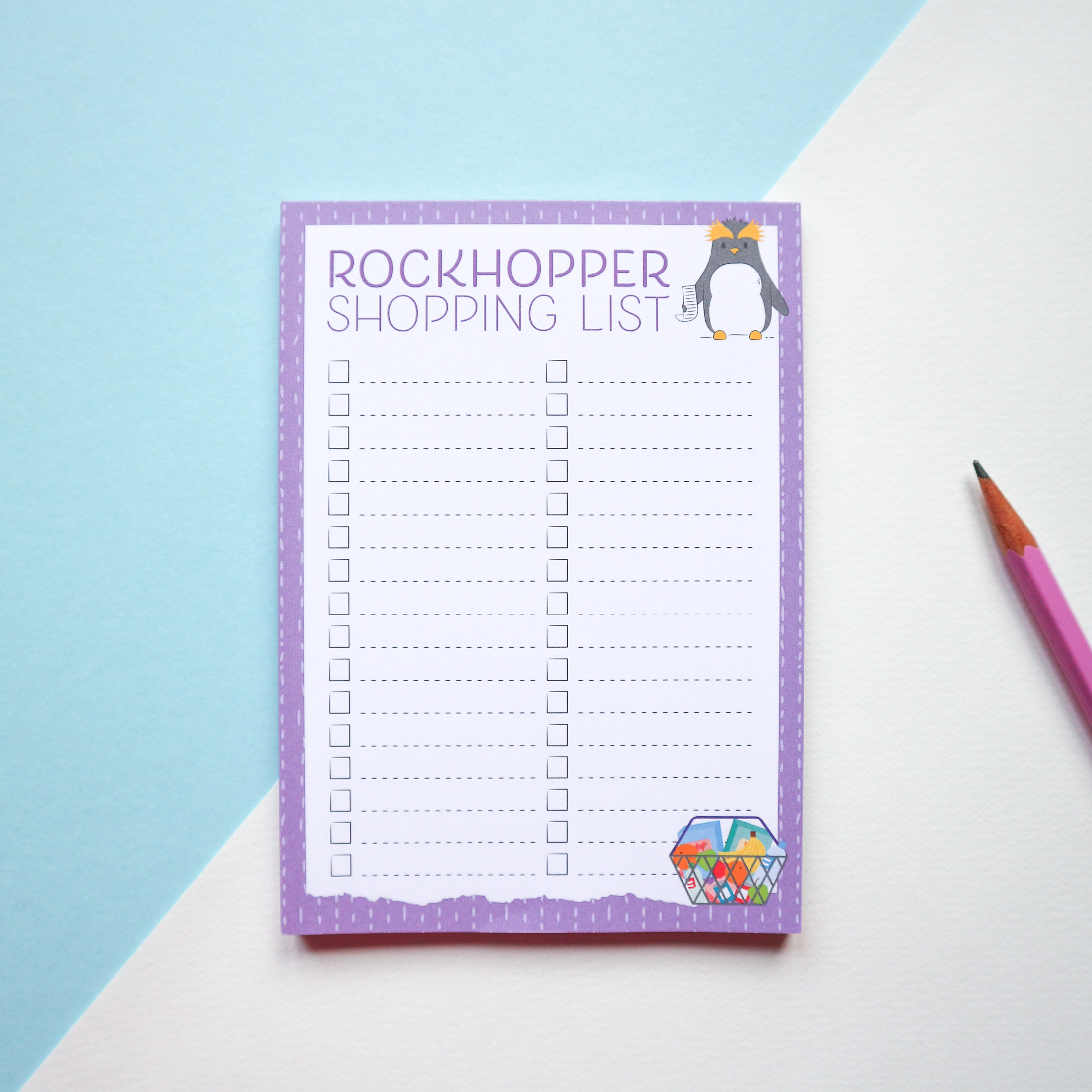 "a penguin-themed shopping list called the ""Rockhopper Shopping List"" showing an illustration of a penguin with a shopping list and a basket of shopping in the corner. Styled with a pink pencil on a blue and white background."