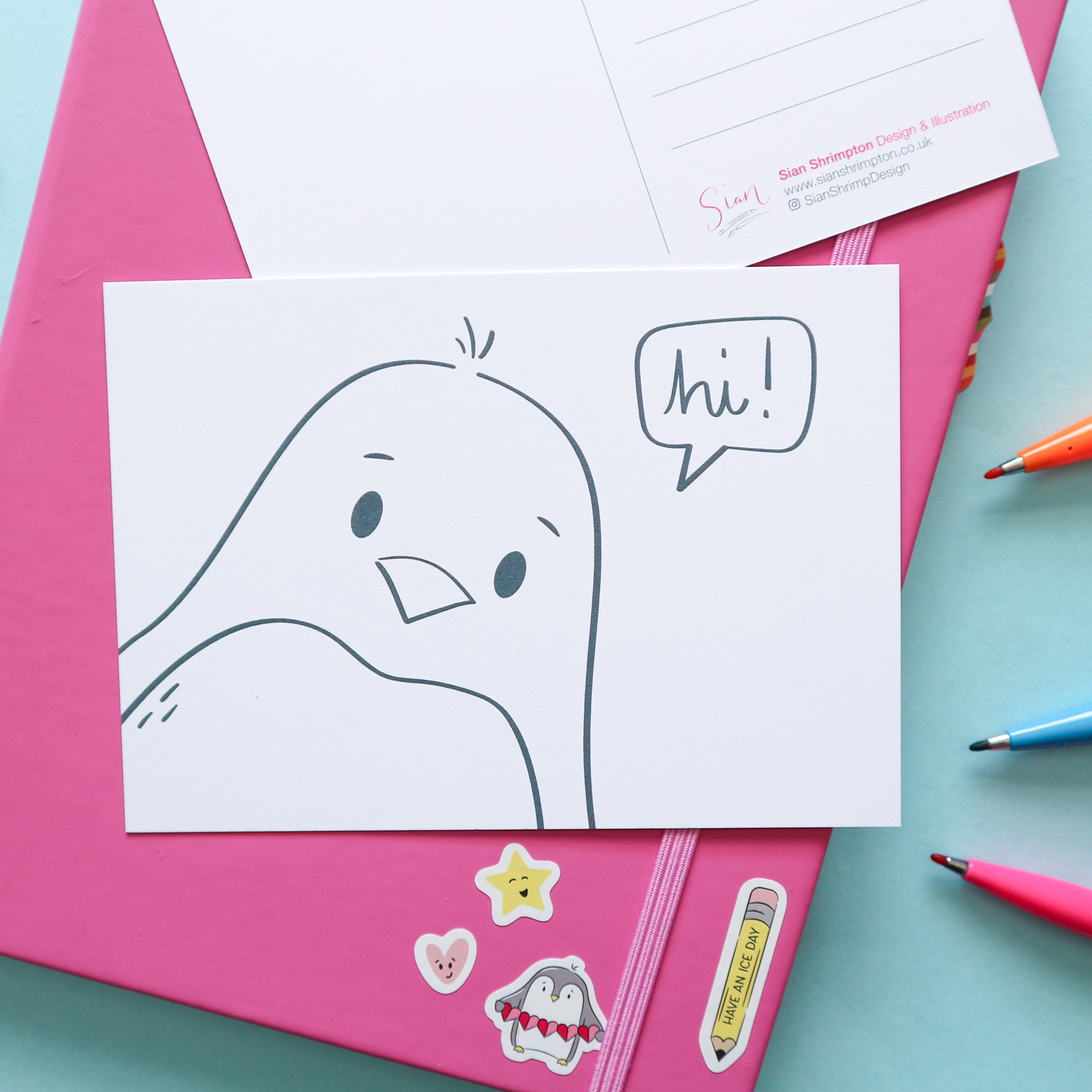 """Postcard design showing an illustration which is un-coloured, to be coloured in by you or the recipient. This design shows a penguin with a speech bubble saying """"hi."""""""