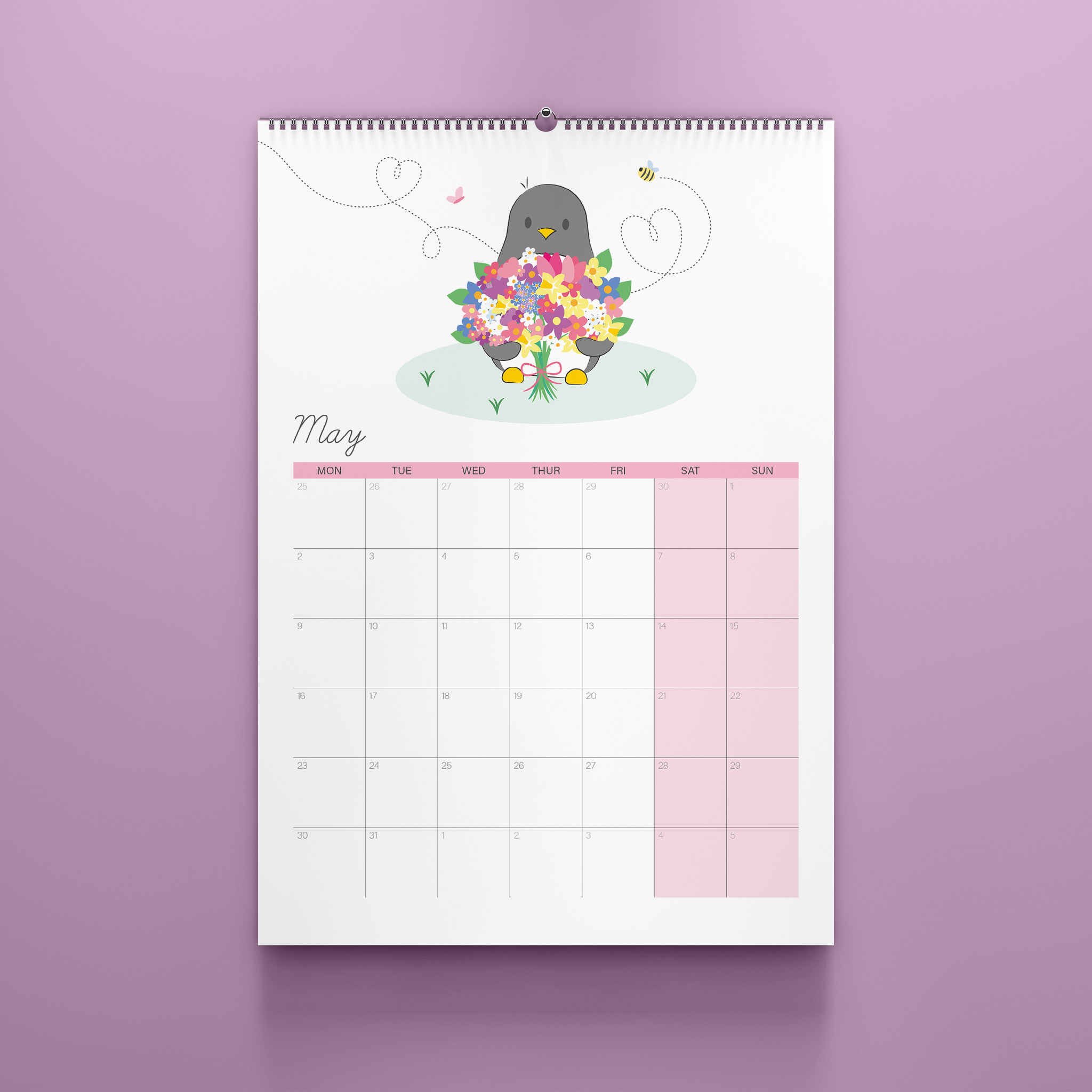 A photo of the May page of the A4 2022 Penguin Calendar. The calendar sits against a lilac background.
