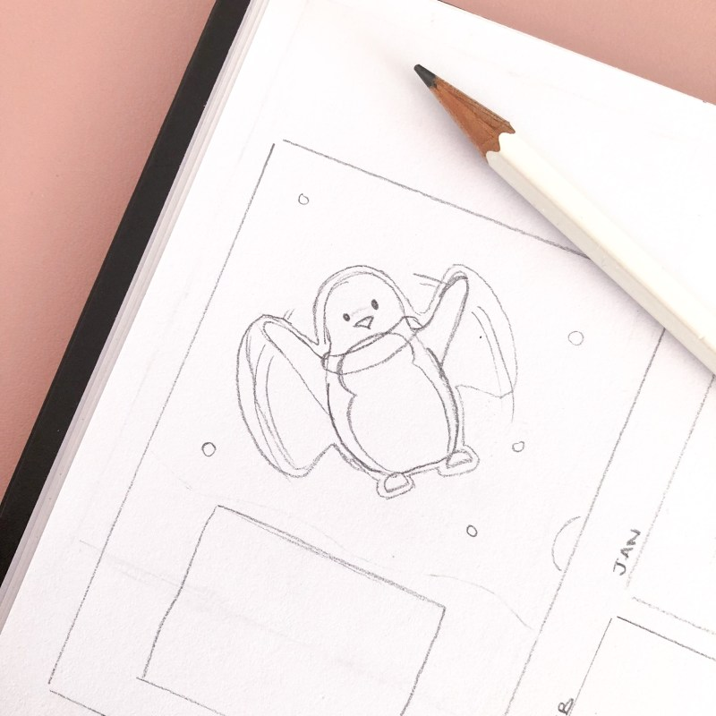 A rough sketch of the January page of the penguin calendar. The sketch shows penguin creating a snow angel.