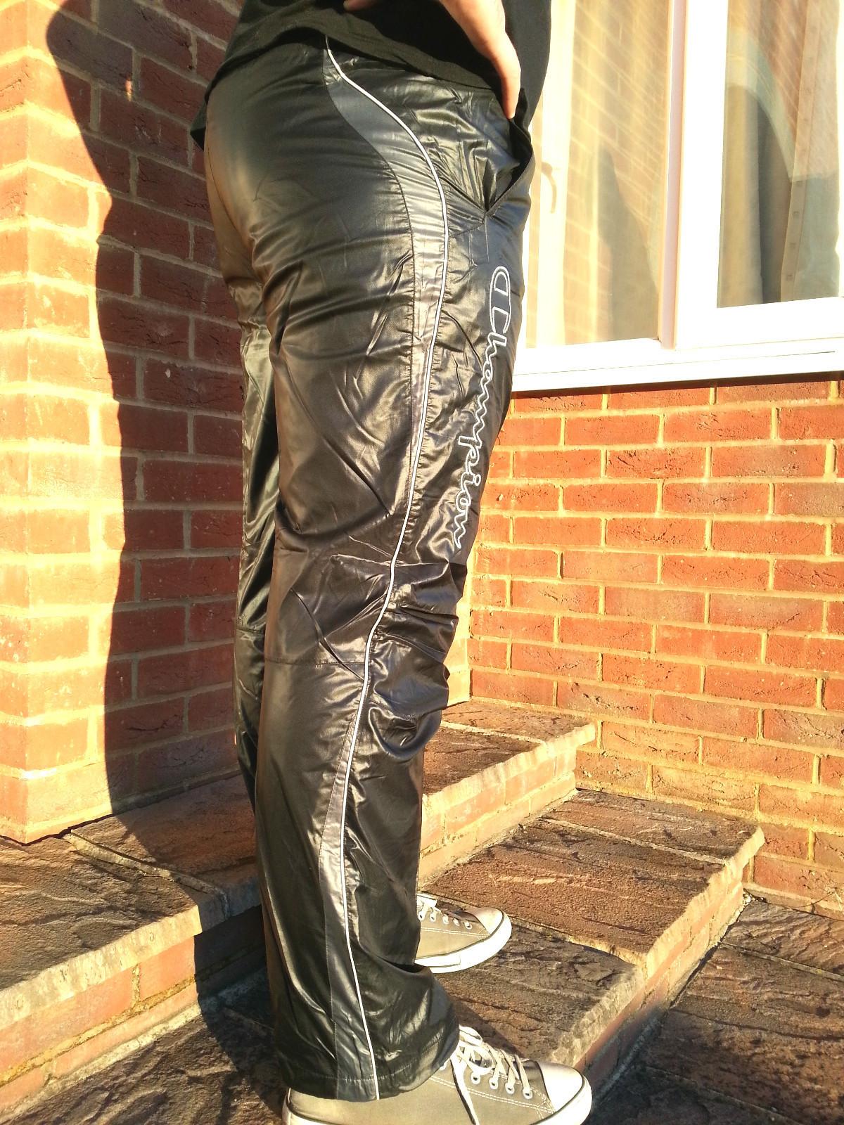 Men's Champion Shiny Nylon Pants in Black Profile View