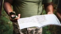 Guide with compass and map