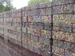 compacted ferrous scrap awaiting packing in a container