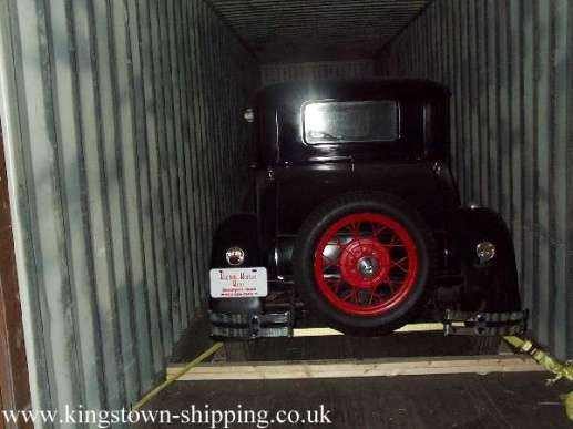 vintage motor vehicle packed in a container