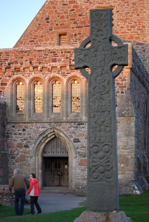 The sun's low rays strike the windows of Iona Abbey just before the evening worship begins.