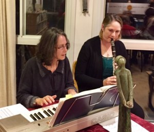 Anita and Sarah lead us in Christmas carols.