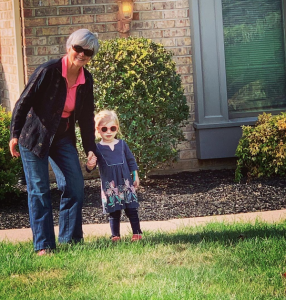 Lydia and Grandma ready to explore the front yard as we walk down the street to the EMU front yard on Homecoming weekend.