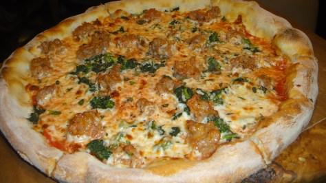 Italian Sausage pizza with Rapini, Caramelized Garlic, and Pecorino Romano