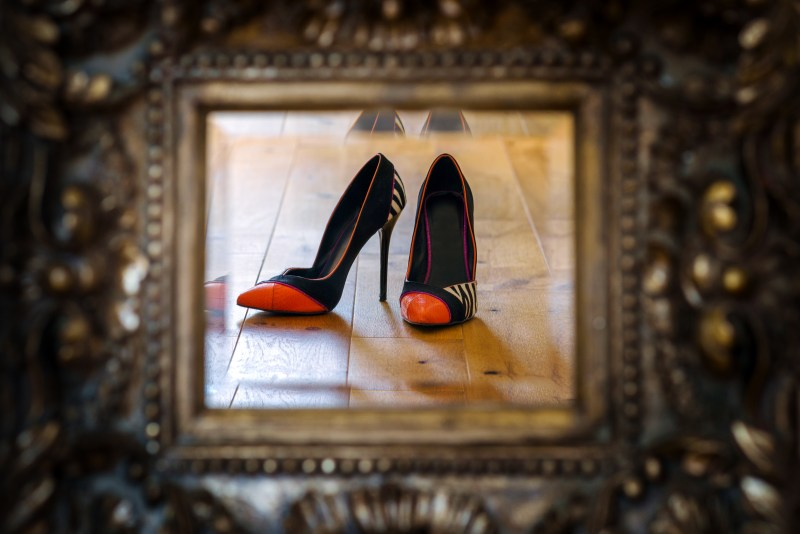 beautiful stiletto shoes in ornate mirror