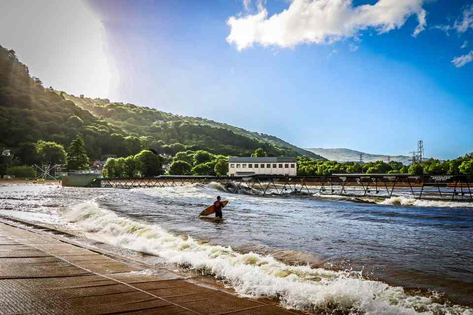 A surfer waiting to catch the waves at Surf Snowdonia