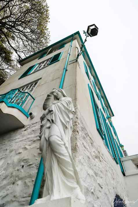 A marble statue of a female outside the Hotel Portmeirion