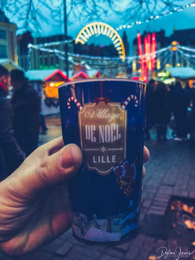 a cup of vin chaud at the christmas market in lille