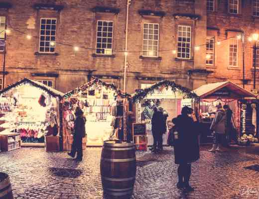 Bath Christmas Market stalls in front of the Hospital of St. John the Baptist
