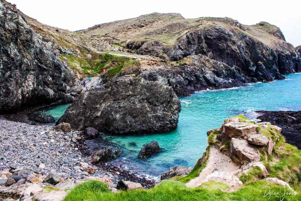 The clear waters of Kynance Cove at high tide, South Cornwall coast