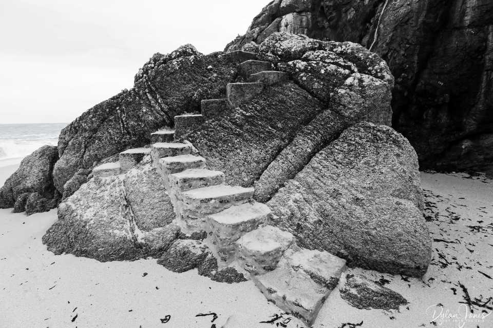 Steps to Porthcurno Beach built into the rocks, South Cornwall coast