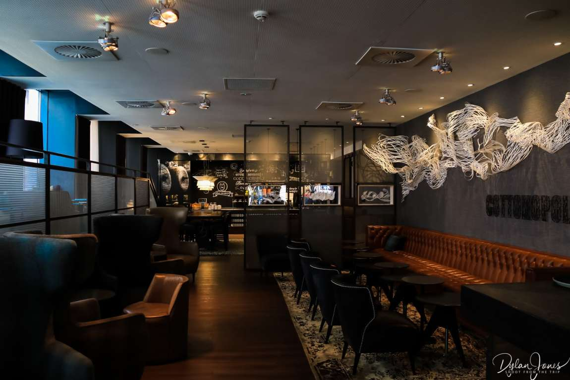 The seating and breakfast areas at Motel One Manchester Royal Exchange