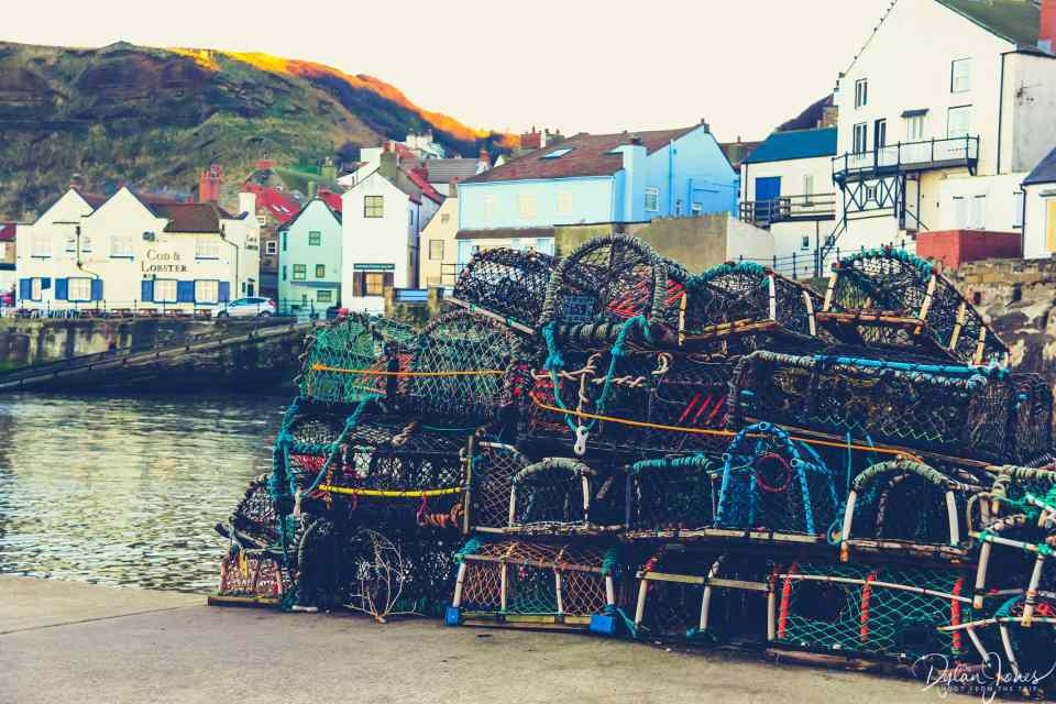 Lobster Pots stacked on the harbour