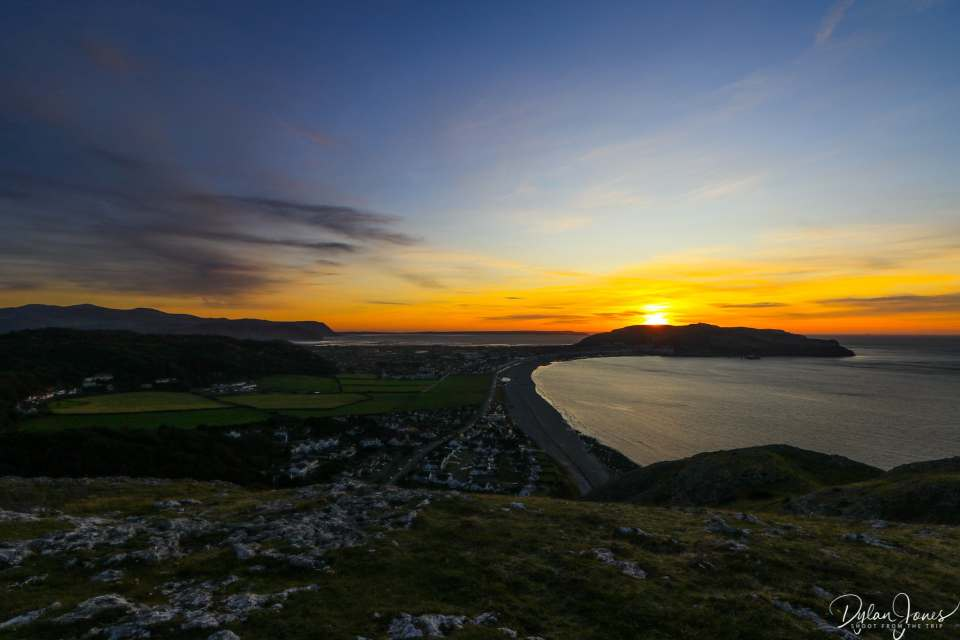 The sun setting behind the Great Orme, from the Little Orme summit