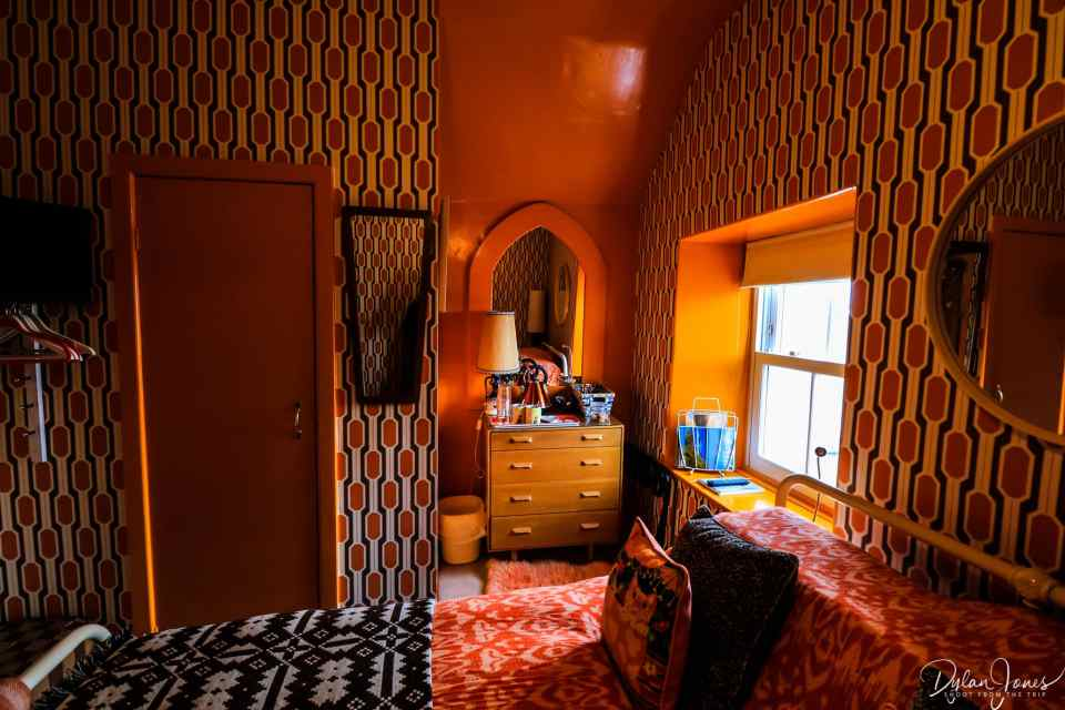 Shades of orange in the Mrs Peel room at the most Instagrammable accommodation in Conwy