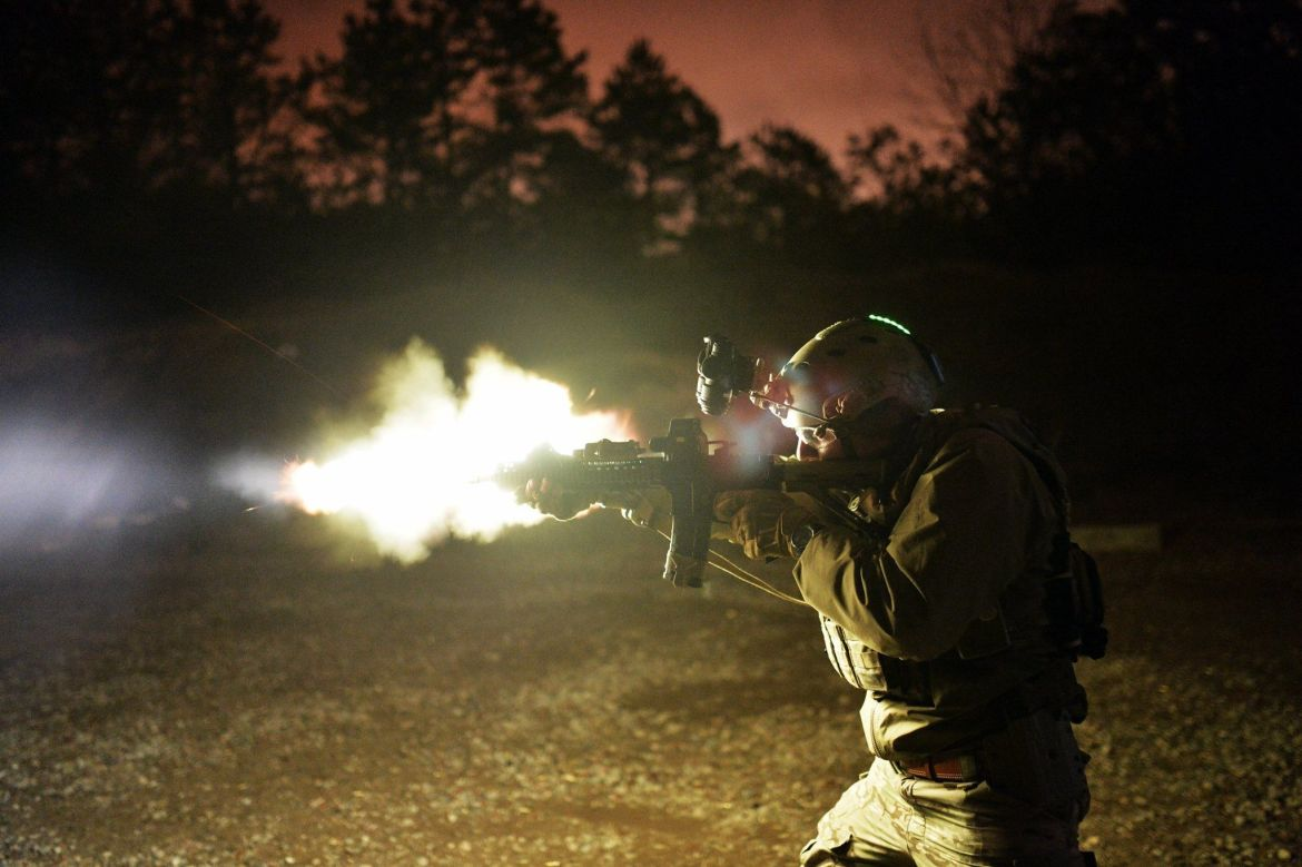 tech-sgt-jason-cangemi-an-armorer-for-the-103rd-rescue-squadron-106th-rescue-wing-test-fires-an-m4-carbine
