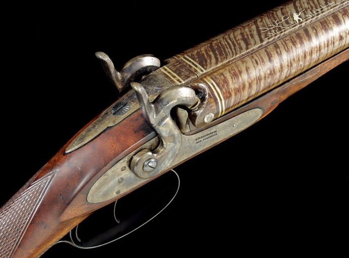 """A 12-gauge percussion gun with locks stamped """"J.P. Clabrough, San Francisco,"""" believed to have been built in 1867."""