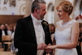 Bride and groom exchange rings at Oakham Castle Wedding Ceremony
