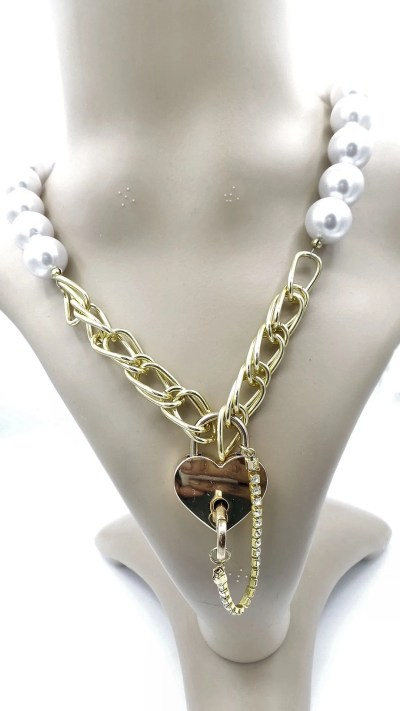 View of faux pearl and gold chain necklace with gold heart shaped padlock on mannequin.