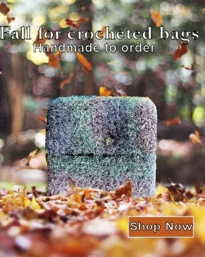 Fuzzy crocheted bag sits among autumn leaves