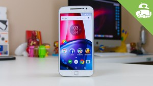 Moto G4 plus cell phone standing upright