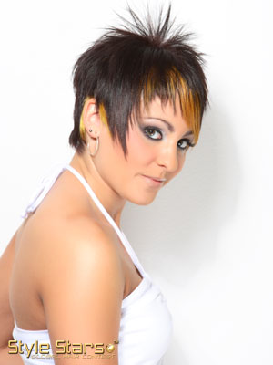 short edgy hair cut with vibrant shade