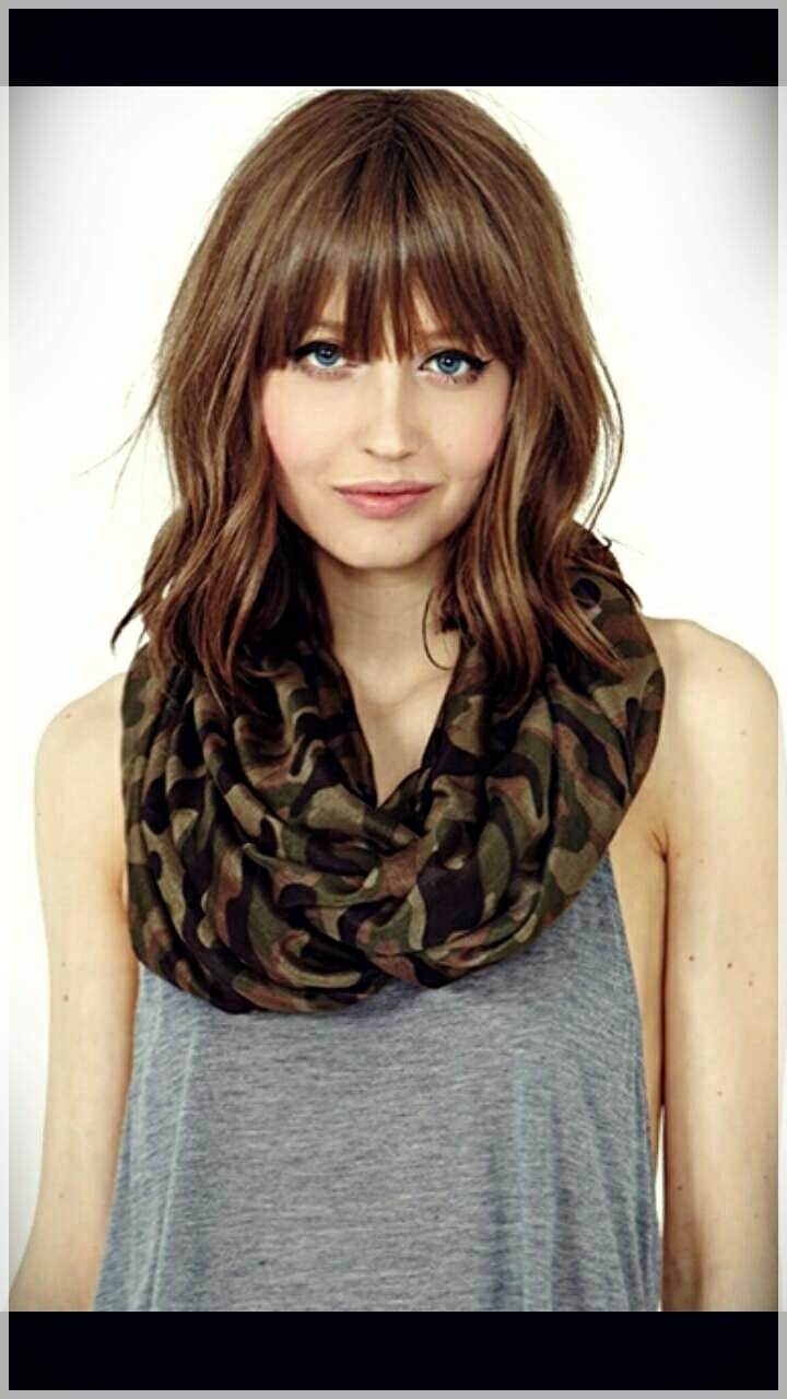 layered haircut with bangs 8 - Why getting bangs will never go out of fashion?