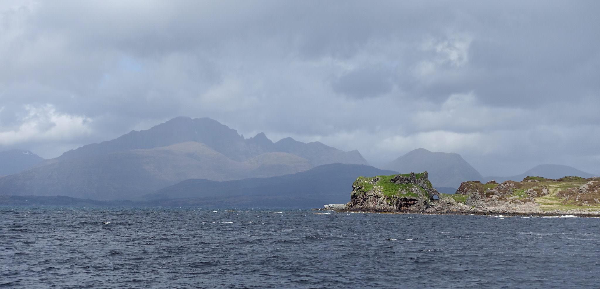 Dunscaith Castle in front the Cuillin