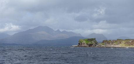 Dunscaith Castle in front the Cuillin