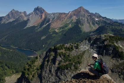Kyle on Yellow Aster Butte's summit. Border Peaks and Tomyhoi Lake in the background.