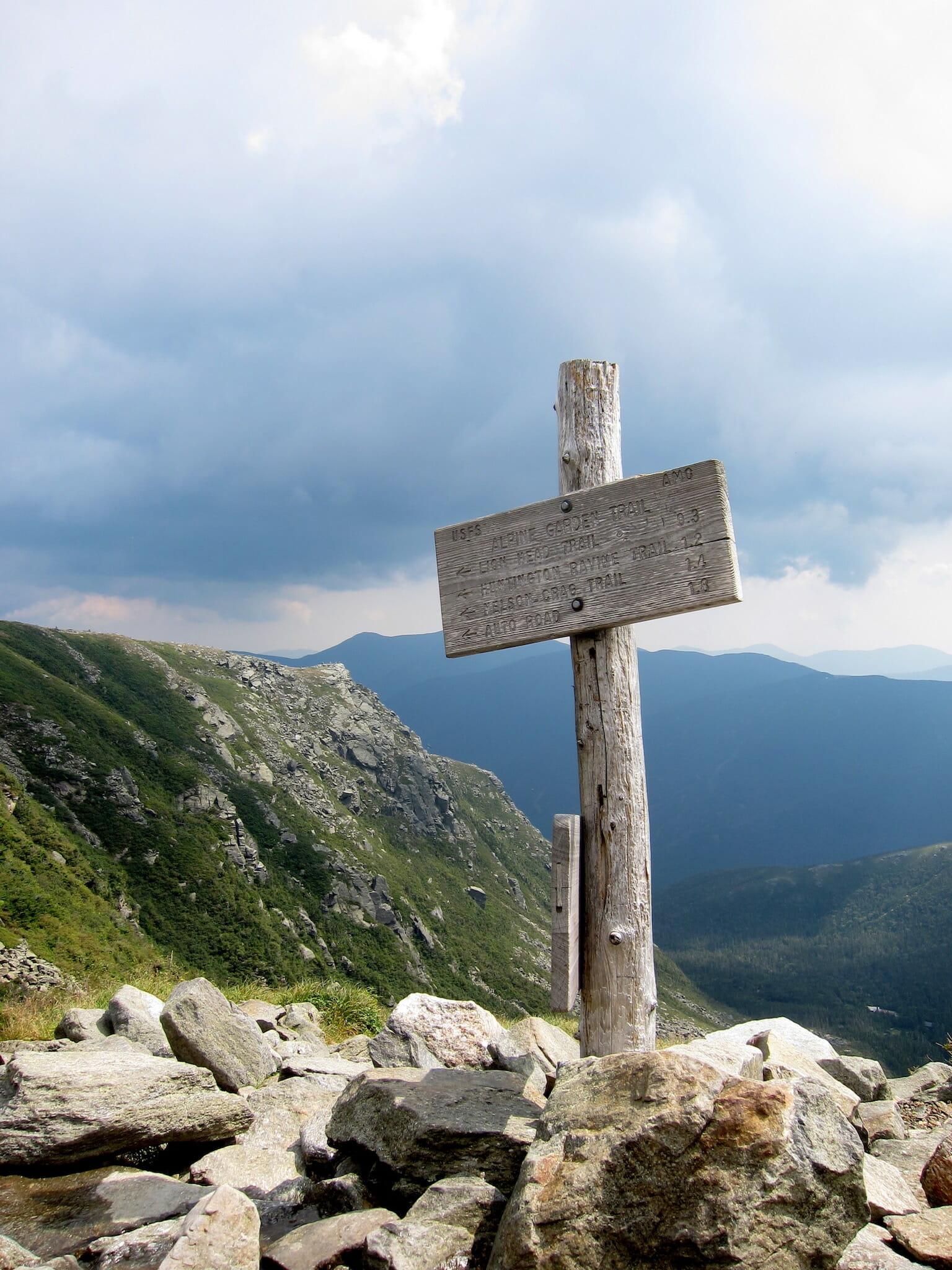 Trail sign at Alpine Garden & Tuckerman Ravine Junction, with Lion Head in the background