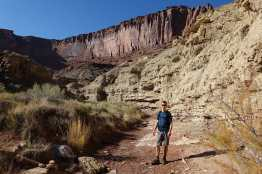 Kyle in a wash, Syncline Loop trail, Canyonlands National Park